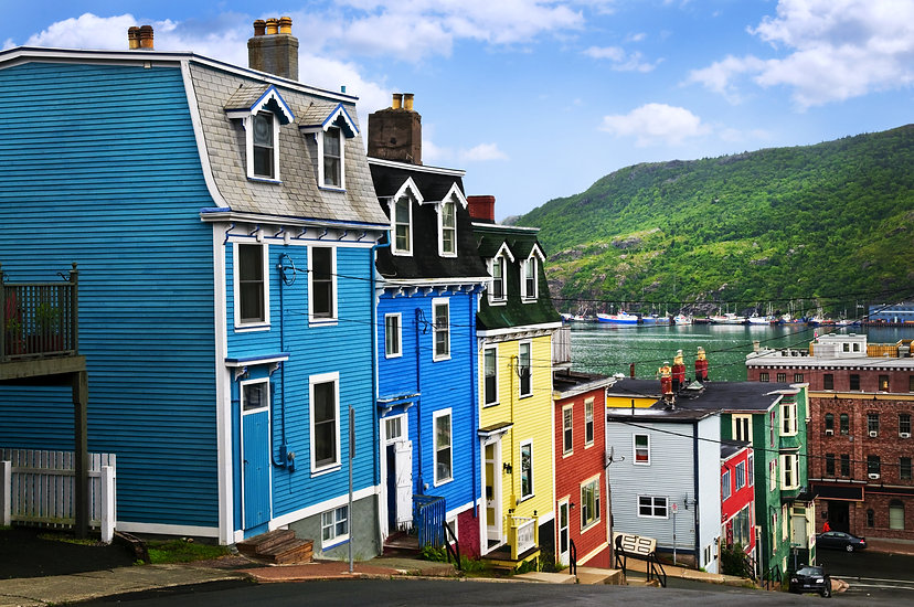 Street with colorful houses near ocean i