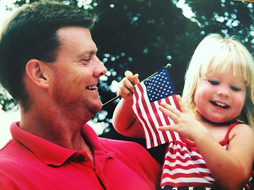 Emily and dad flag pic.jpeg
