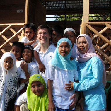"""With the kids of Orphans International Worldwide Sumatera after the Tsunami in Aceh, Indonesia. This picture was used in the New York Post with the title """"Tsunami Saint"""""""