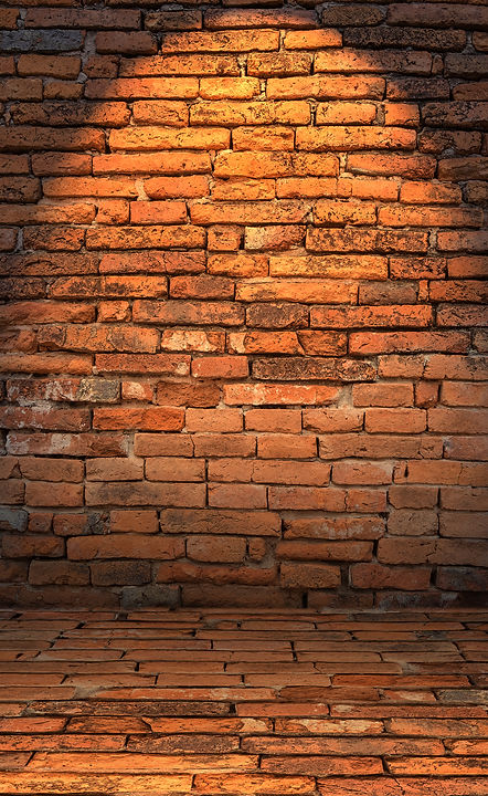 Low Key Photo Of Red Brick Wall With Lighting Effect..jpg