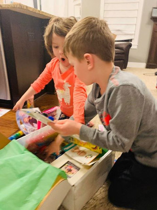 Alia and her brother open the Creative Care Package.