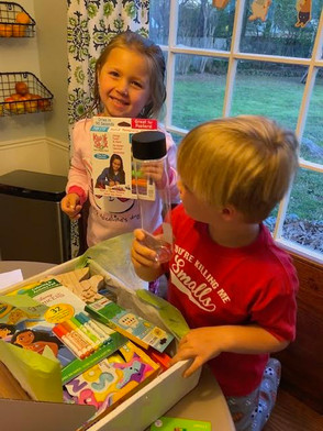 Olivia opens her Creative Care Package.j