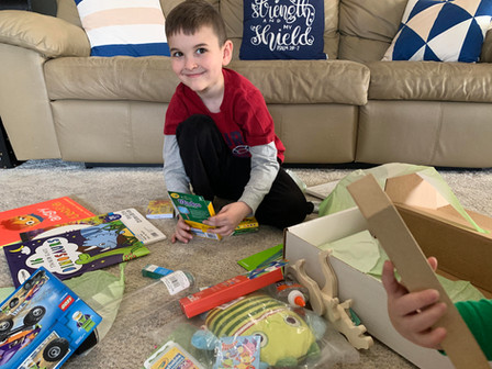 Zander opens his Creative Care Package.