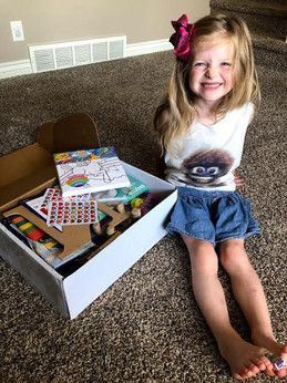 Nora  receives her Creative Care Package.