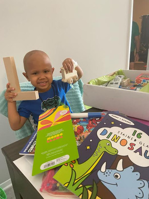 Lucas opens his Creative Care Package!!