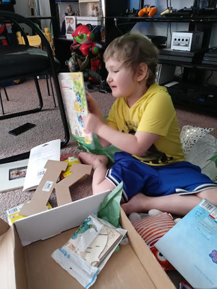 Kyler explores his Creative Care Package.