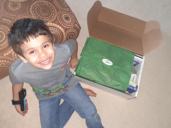 Isaiah receives his package.