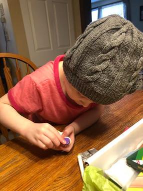 Cora explores her Creative CarePackage