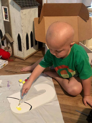 Caleb Painting His Letter.