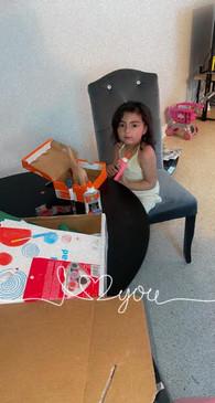 Anya works on her dinosaur