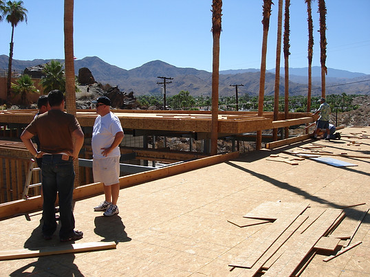 Hector inspecting framing for project.