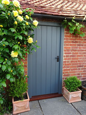 grey door with yellow roses