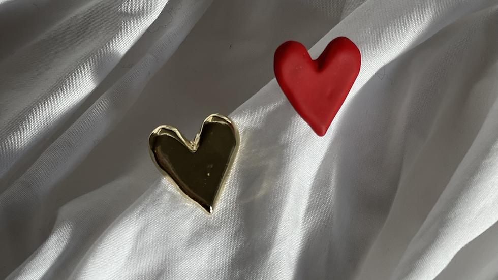 Odd heart studs