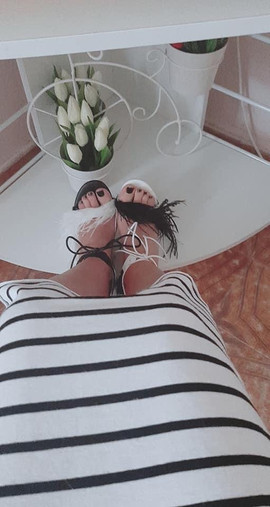 Valentina wears mismatched Magpie sandals by Gen Nee (Italy May 2020)