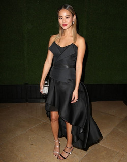 Jamie Chung with mismatched heeled sandals