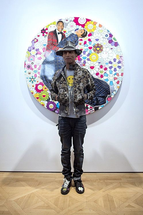 Pharrell Williams with mismatched shoes 2