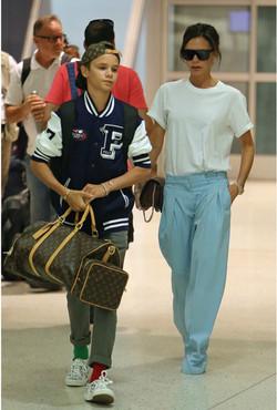 Romeo Beckham in mismatched socks