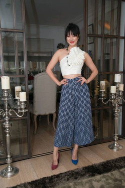 Betty Bachz with mismatched pumps