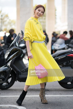Irene Kim poses after the Sacai Show with mismatched shoes