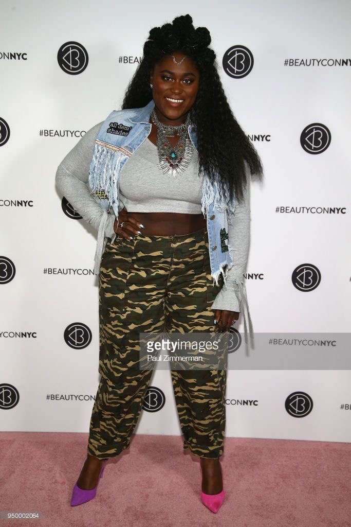 Danielle Brooks with mismatched shoes