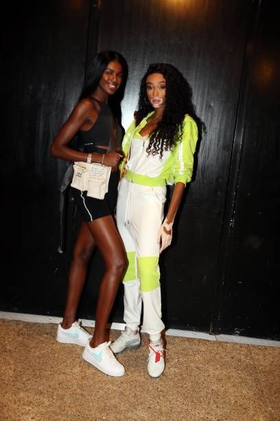 Leomie Anderson (L) and Winnie Harlow with mismatched shoes