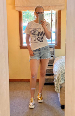 Irina wears mismatched and studded sneakers Song by Gen Nee