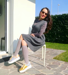 Silvia wears mismatched and studded sneakers Song by Gen Nee