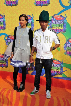Pharrell Williams with mismatched shoes