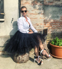 Enrica, founder of Mamma Power movement, wears mismatched Magpie sandals by Gen Nee (Italy May 2020)
