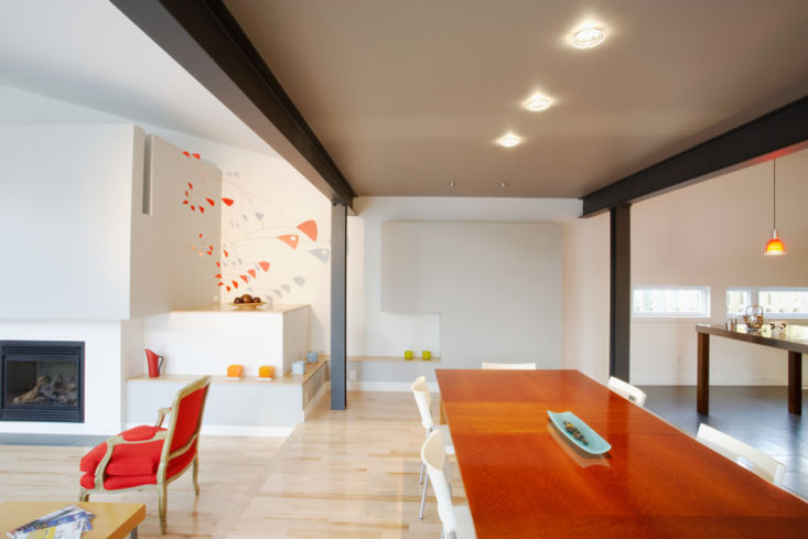 Dining Room, red orange accent colour, bright and airy space