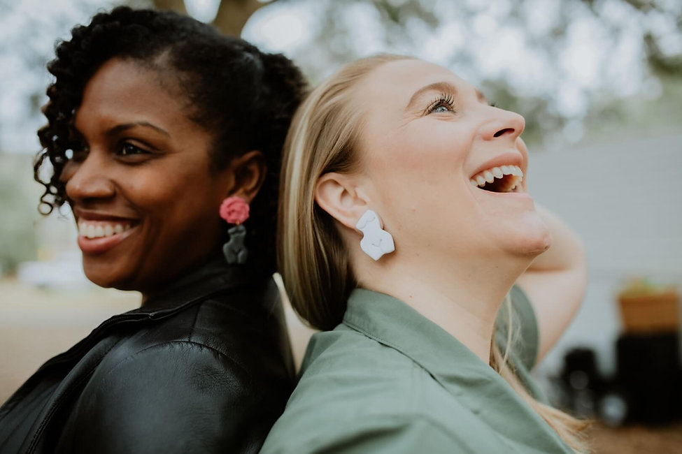 Two women wearing Attia Designs' earrings