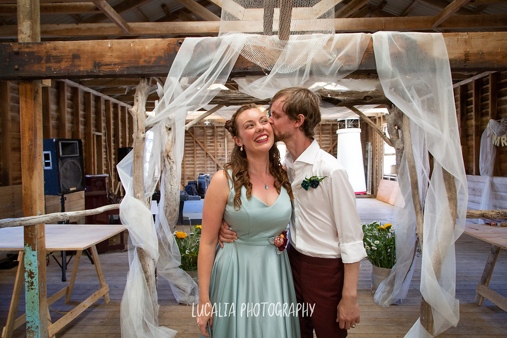 wedding couple entering the Woolshed, Castlepoint Wairarapa wedding, Lucalia Photography