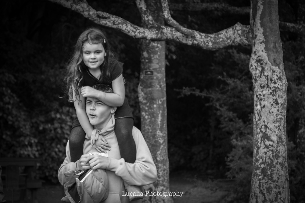 younger sister sits on older brother's shoulders, Wairarapa family photographer