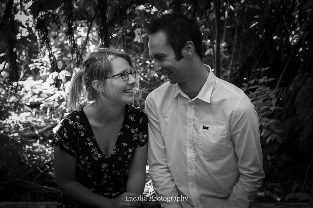 engaged couple sitting and laughing, Zealandia, Wellington
