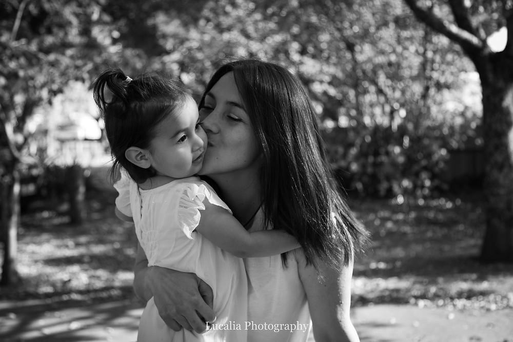 mum kissing her daughter on the cheek, Carterton, Wairarapa family photographer