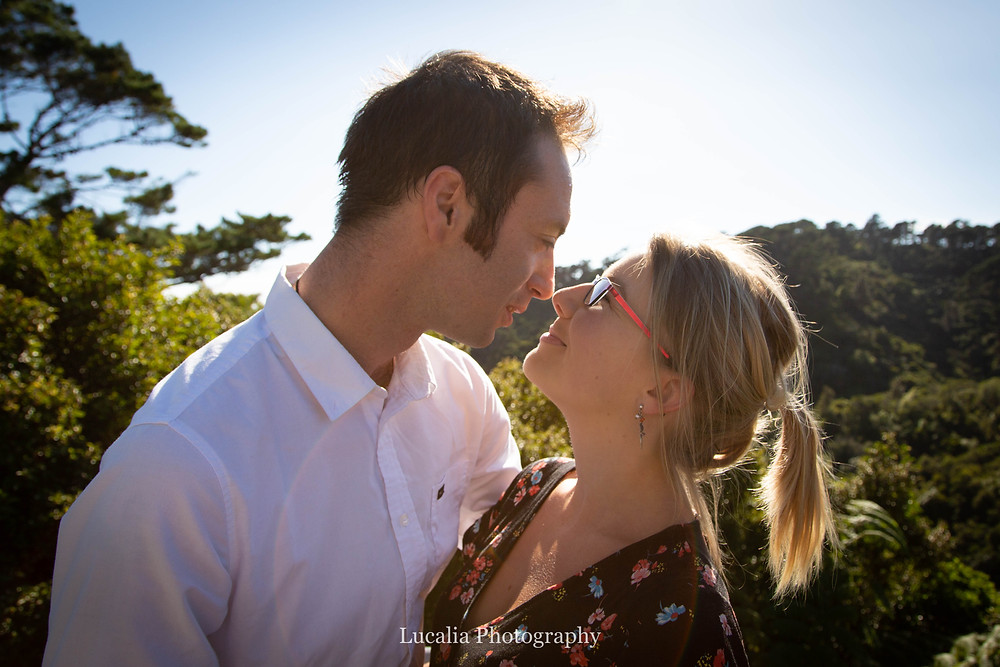 engaged couple about to kiss during golden hour, Zealandia, Wellington