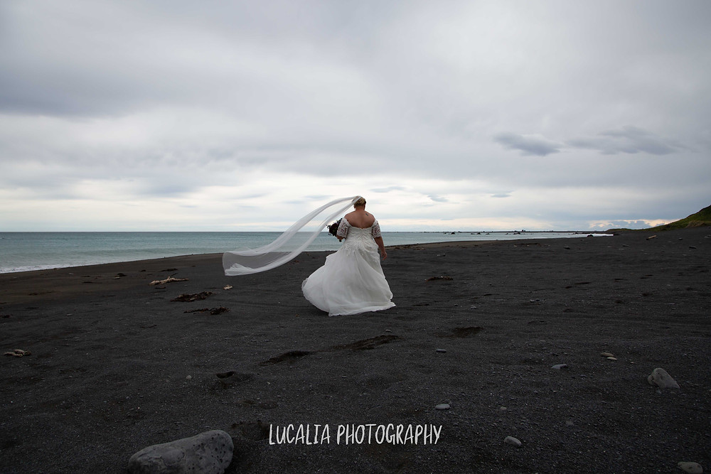 bride with veil blowing in the wind, Ngawi, Wairarapa wedding
