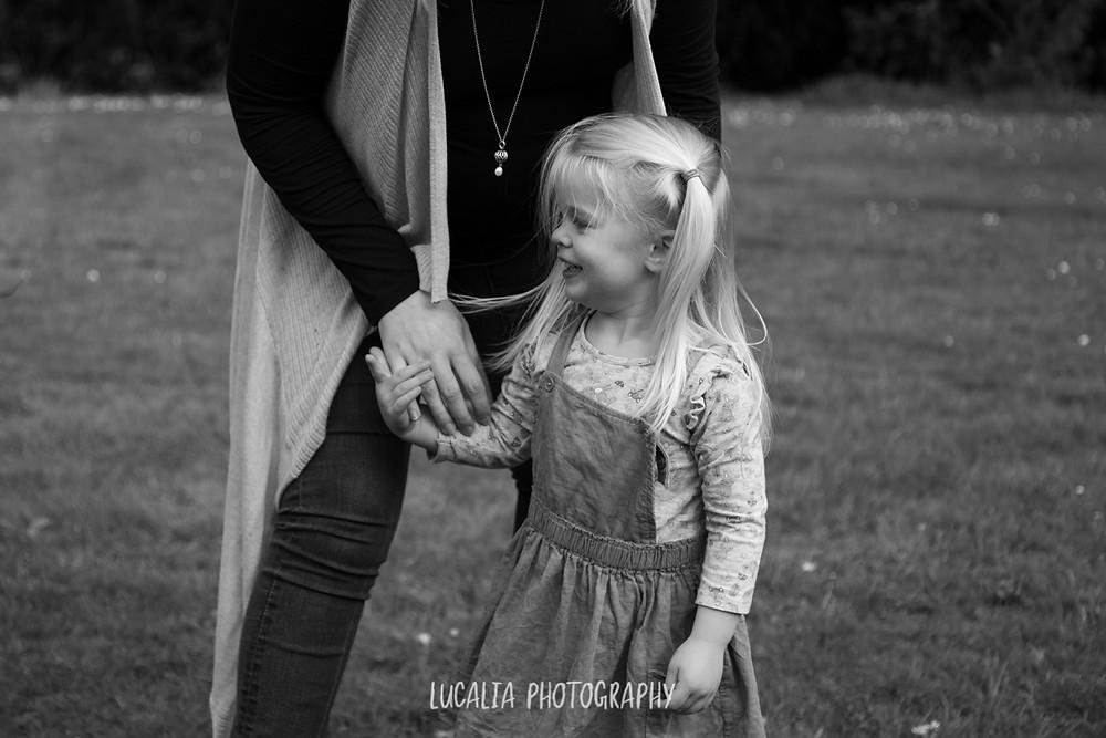 daughter holding mum's hand, Wairarapa family photographer
