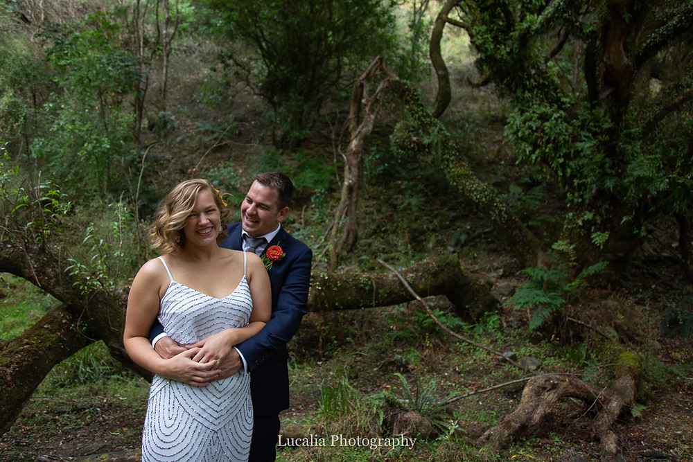 groom looking at his bride in forest, Wairarapa wedding photographers