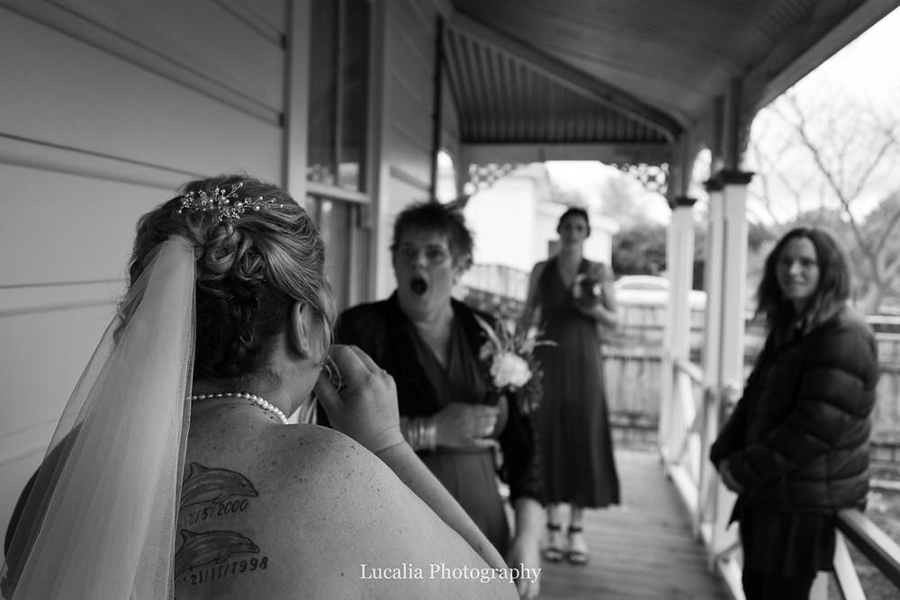 bridesmaids reaction to bride in dress, Wairarapa wedding photographer