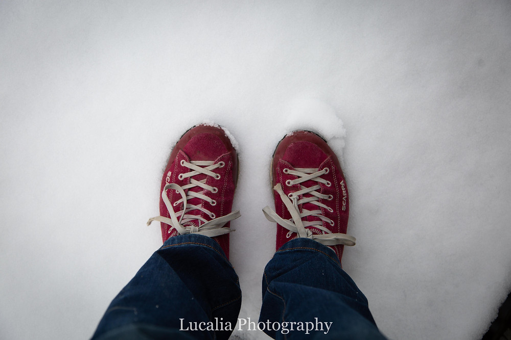 Red shoes standing in snow at The Summit, Maydena Bike Park cafe