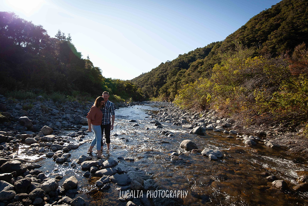 engaged couple walking across the river, Mt Holdsworth, Wairarapa wedding photographer