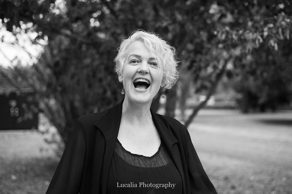Wairarapa wedding celebrant Rachel Clarke laughing in Queen Elizabeth Park