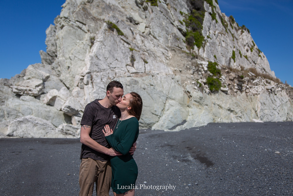 engaged couple kissing with rocks in the background, Wairarapa wedding photographer