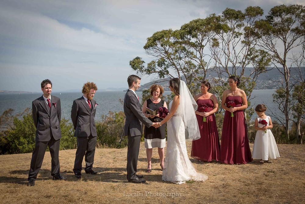 outdoor wedding ceremony with river and mountain in the background