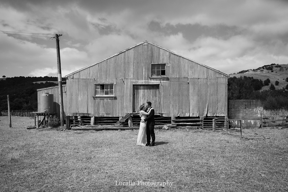 bride and groom kiss outside woolshed, Wairarapa wedding photographers