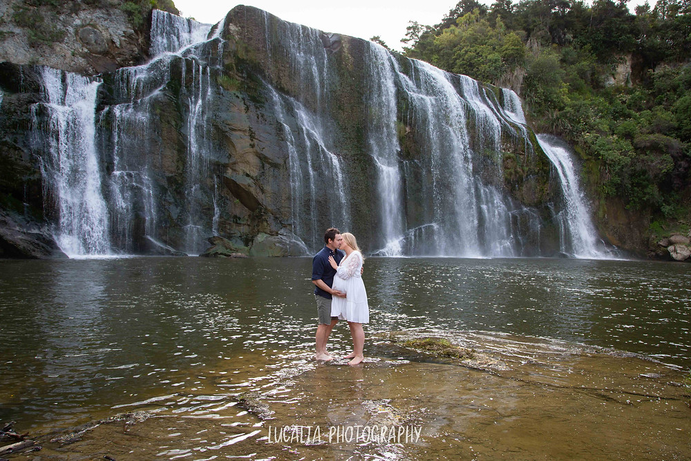pregnant couple embracing in waterfall, Wahi Falls, Tararua, Lucalia Photography