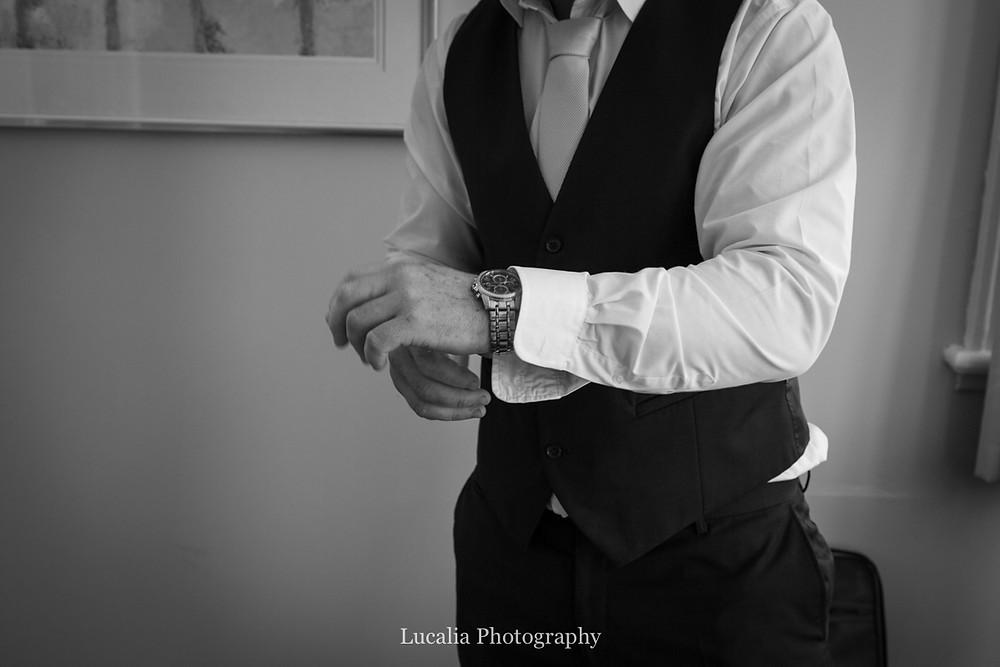 groom putting on his watch on his wedding day, Wairarapa