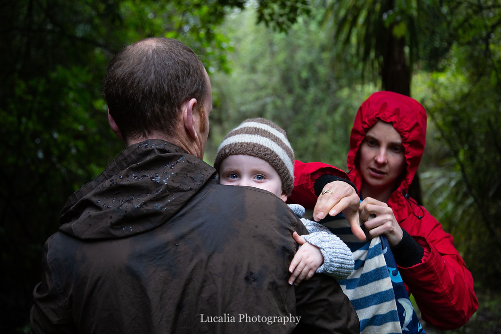 son looking over dad's shoulder whilst mum fixed jumper in the rain, Wairarapa family photographer