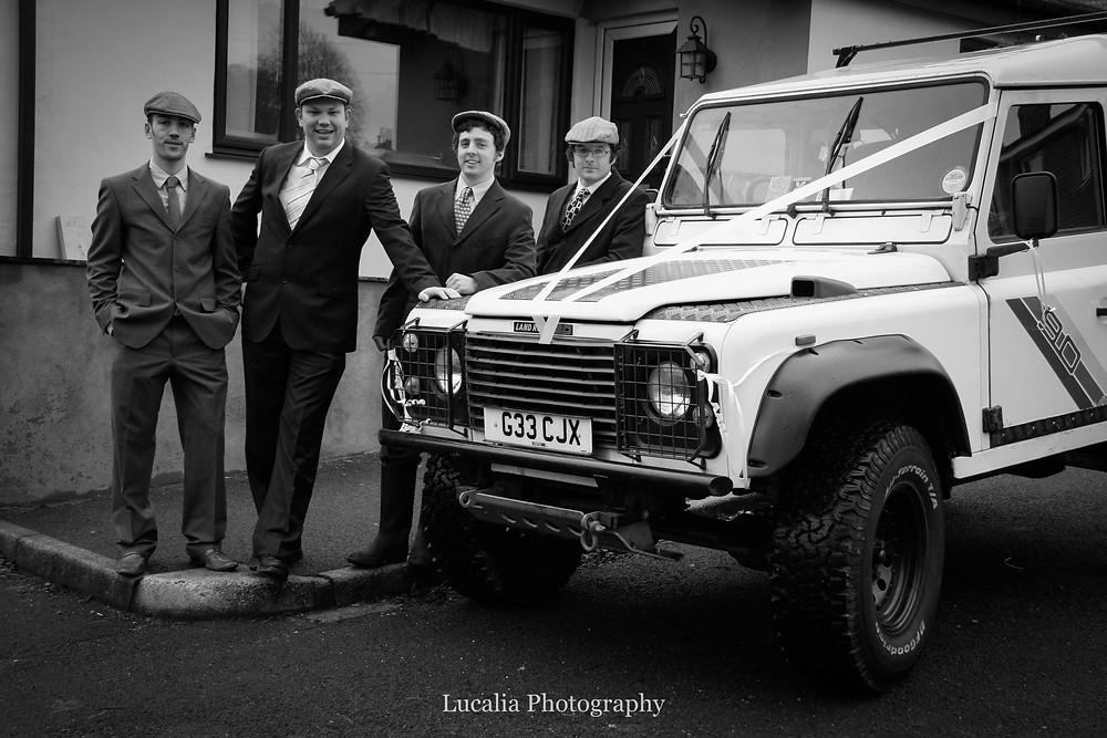 groom and groomsmen with Land Rover Defender wedding car, Wairarapa wedding photographer